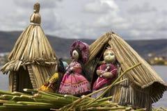 Floating island Uros near Puno. Dolls on a tiny floating island made of cane on Uros near Puno Royalty Free Stock Photos