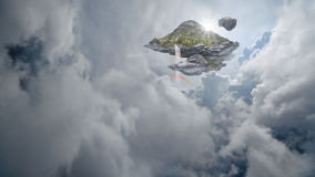 Floating island with waterfalls and rainbows Royalty Free Stock Photos