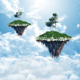 Floating islands in the clouds Royalty Free Stock Photo