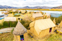 Floating Islands on Lake Titicaca Puno, Peru, South America, thatched home. Dense root that plants Khili Royalty Free Stock Image
