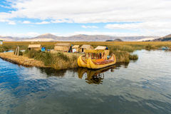 Floating Islands on Lake Titicaca Puno, Peru, South America, thatched home. Dense root that plants Khili interweave Royalty Free Stock Photography