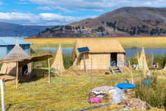 Floating Islands on Lake Titicaca Puno, Peru, South America, thatched home. Dense root that plants Khili interweave Royalty Free Stock Photos