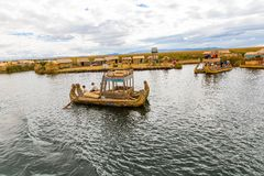Floating Islands on Lake Titicaca Puno, Peru, South America, thatched home. Dense root that plants Khili Royalty Free Stock Photos