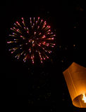 Floating lantern with firework Royalty Free Stock Images