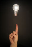 Floating Light Bulb and Hand Royalty Free Stock Photo