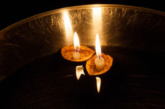 Floating lighted candles in nutshells Royalty Free Stock Photos