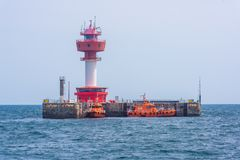 Floating lighthouse and boat in Kiel royalty free stock photos