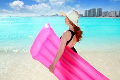 Floating lounge pink girl in caribbean beach Stock Photos