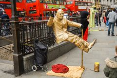 Floating man,street artist. London, London`s West End in the City of Westminster, UK, February 21, 2015. Piccadilly circus.Floating man,street artist Royalty Free Stock Images
