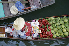 Floating market 1. A fruit vendor in a boat at floating market near Bangkok, Thailand Royalty Free Stock Images