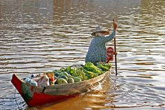 Floating market. Woman in boat with fruits and vegatables Stock Photo