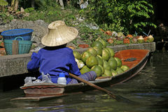 Floating market 2. A peasant in the boat with a harvest of pomelos at the floating market near Bangkok, Thailand Royalty Free Stock Photo