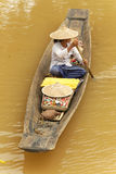 Floating market. Woman on a small rowboat at Myanmar floating market Stock Images