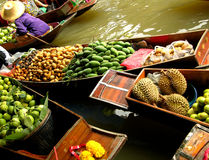 Floating Market. The Damnoen Saduak Floating Market is located at Damnoen Saduak District, Ratchaburi Province, about 85 kms from Bangkok, Thailand. According to royalty free stock image