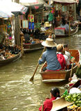 Floating Market. The Damnoen Saduak Floating Market is located at Damnoen Saduak District, Ratchaburi Province, about 85 kms from Bangkok, Thailand. According to