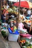 Floating market, Bangkok. People selling food at floating market outside Bangkok Royalty Free Stock Photos