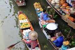 Floating market, Bangkok. People selling food at floating market outside Bangkok Stock Photo