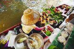 Floating market in Bangkok. Cuisine on the boat -  Bangkok, Thailand Royalty Free Stock Photo