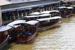 Floating market in Bangkok, tourists boat trip. In brown river of Thailand Royalty Free Stock Photo