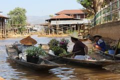 Floating market and boat souvenir seller in Inle, Royalty Free Stock Images