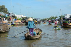 Floating market in Can Tho, Vietnam. People rowing at floating market in Can Tho, southern Vietnam Royalty Free Stock Photos