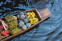 Floating market. Damnoen Saduak floating market, Traditional fruit shop on boat Royalty Free Stock Photo