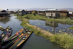 Floating MArket on Inle Lake and Typical floating houses on Inle Lake Stock Photo