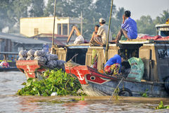 Floating market, Mekong Delta, Can Tho, Vietnam. Cargo boats with vendors at the Mekong river in the Mekong delta, Can Tho, Vietnam. Waiting for people to sell Stock Photography
