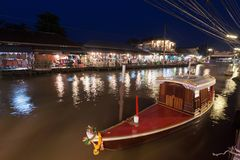 Floating market at night in Amphawa, Samut Songkhram , Thailand. royalty free stock image