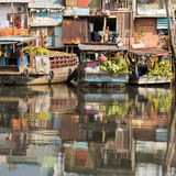Floating market with reflection in water. Royalty Free Stock Photography
