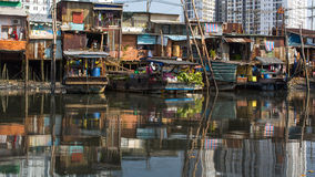 Floating market with reflection in water. Royalty Free Stock Images