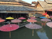 Floating Market in Thailand. Multi-colored umbrellas floating wind Stock Images