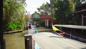 Floating market in Thailand. The traditional market on the water in Bangkok. stock video