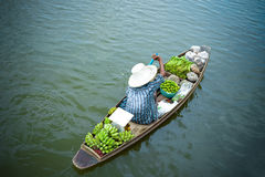 Floating Market, Thailand. A woman paddling a boat at a local floating market and popular tourist destination near Bangkok, Thailand Stock Images