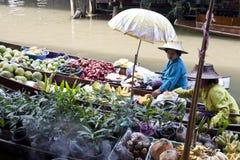 Floating Market Vendors. Vendors selling plants and food stop to chat at Damnoen Saduak floating market near Bangkok, Thailand Stock Image