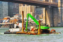 Free Floating Means For Transporting The Crane On A Raft Along The Wa Royalty Free Stock Photos - 120832838