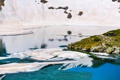 Floating melting ice blocks at the lake Stock Photos