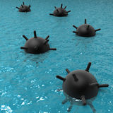 Floating mines at sea. Several black naval mines floating on the surface of the sea Royalty Free Stock Photography