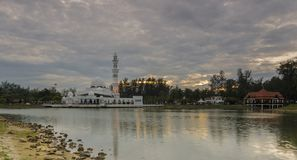Floating mosque during sunset with dramatic clouds. View of Floating mosque also known as Tengku Zaharah mosque with a majestic clouds during sunset near the Stock Photography