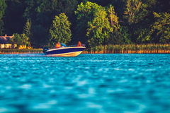 Floating motorboat Stock Images