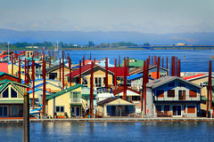 Floating Neighborhood Closeup. A closeup view of a neighborhood of several float homes on calm water in Portland Oregon on Columbia River. Washington state Royalty Free Stock Photo