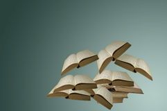 Floating Open Books. Several open books floating in the air Royalty Free Stock Photography