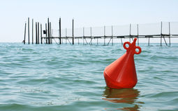 Floating orange buoy royalty free stock photography