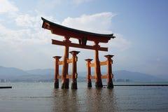 Floating orange shinto shrine of Miyajima in the Hiroshima region, Japan on the Itsakushima island during the sunset Royalty Free Stock Photography