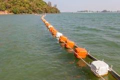 Floating orange and white buoys for marking safety zone. Stock Images