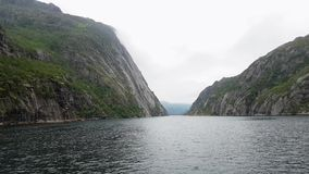 Floating out Trollfjord on yacht. Cloudy weather stock footage