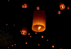 Floating paper lantern in night sky Royalty Free Stock Images