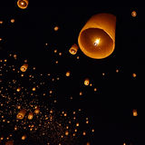 Floating paper lantern in night sky Stock Photography