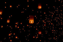 Floating paper lantern in night sky Stock Images