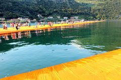 The Floating Piers, Iseo Lake, Italy. The Floating Piers was a site-specific work of art by the Bulgarian born American artist Christo, consisting of 100,000 Royalty Free Stock Photo